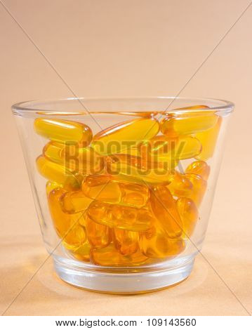 Omega 3 Capsules From Fish Oil On Pastel Background.