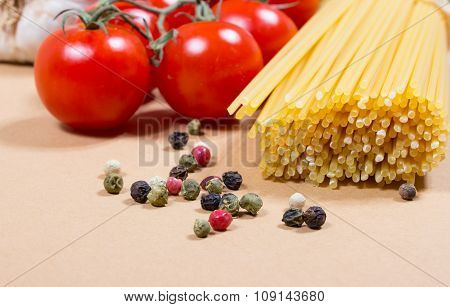 Raw Pasta And Ingredients For Pasta With Tomatoes And Basil.