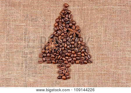 Shape of christmas tree made of coffee beans on burlap