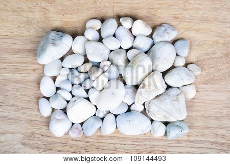 Clean white pebbles closeup like background.