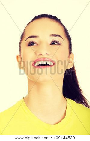 Beautiful laughing young student woman.