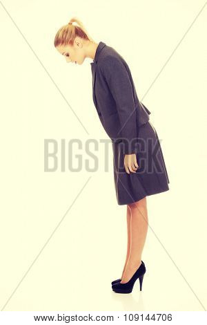 Business woman looking down on copy space.