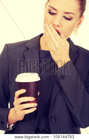 Exhausted businesswoman with a coffee.
