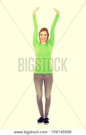 Happy caucasian woman with arms up.