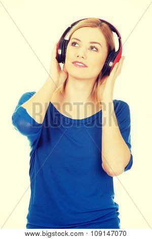 Young motion woman with headphones listening to music.