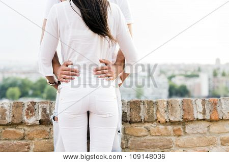 Young Couple Holding Each Other Around Waist