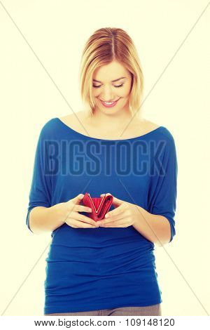 Happy caucasian woman with a wallet.