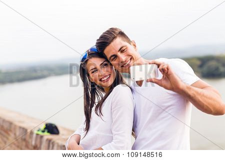 Young Beautiful Couple Taking A Selfie Of Themselves