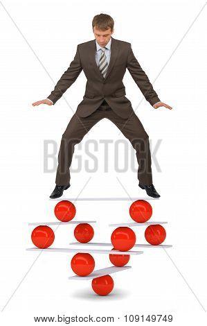Businessman on balance balls