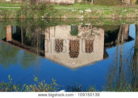 Reflected In The Water Of Uninhabited Farmhouse
