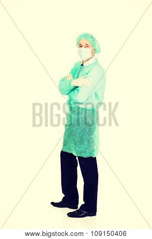 Mature male doctor wearing protective clothes.