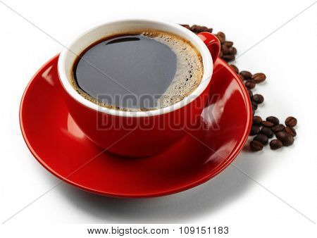 A red cup of tasty drink and scattered coffee grains, isolated on white