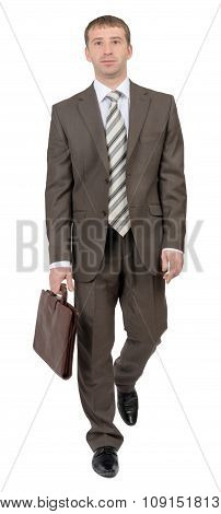 Businessman with suitcase looking at camera