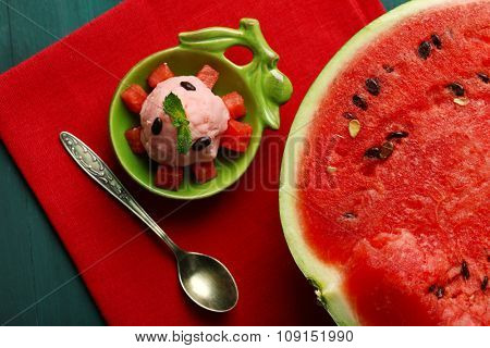 Watermelon ice cream in bowl  on color wooden background