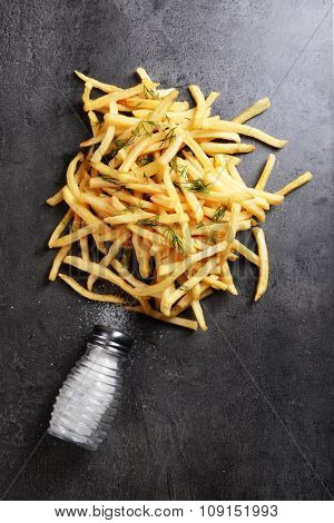 french fries with salt and dill on table