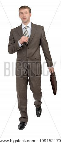 Businessman with suitcase running