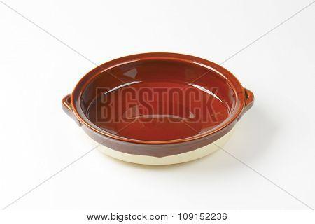 Empty round ceramic baking dish