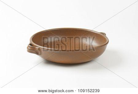 Empty round brown baking dish