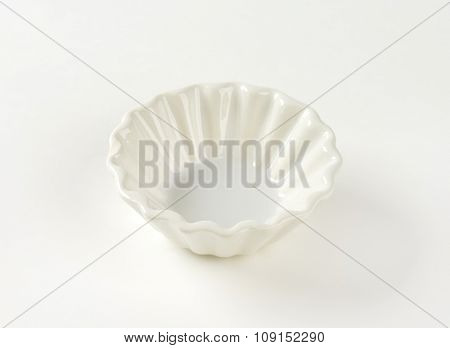 Small fluted white snack bowl