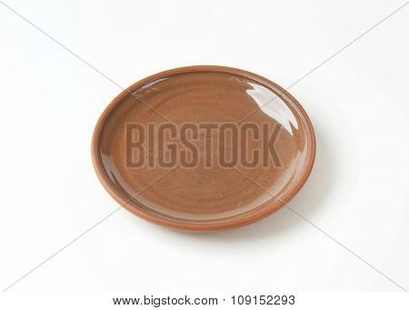 Round brown ceramic dinner plate