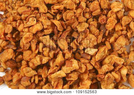heap of salty pork greaves (top view)