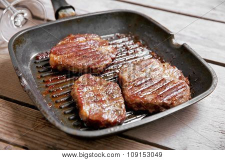 Roasted beef fillet on pan, on wooden background