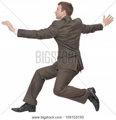 Businessman running on white