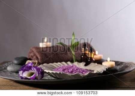Beautiful spa composition in a bowl on wooden table