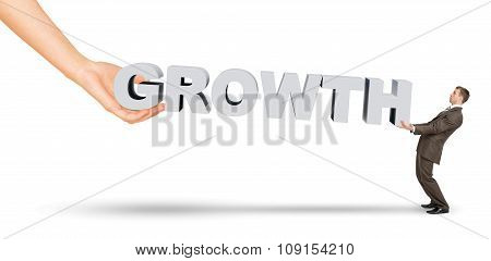 Businessman and hand holding word growth