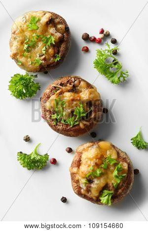 Stuffed mushrooms on plate, on table background