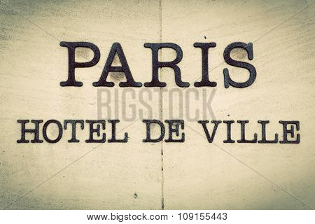 Paris Hotel de Ville - Parisian city hall inscription on the building. Vintage, retro