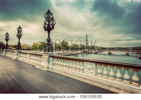 Pont Alexandre III bridge in Paris, France. Seine river and Eiffel Tower. Vintage