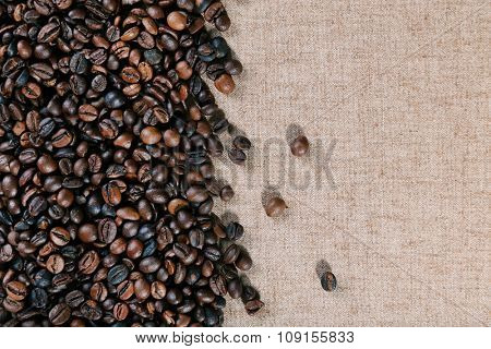 Roasted coffee beans on the linen fabric