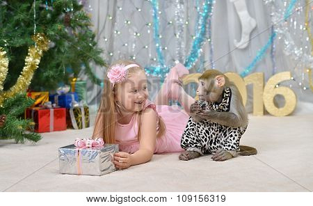 greeting card with monkey, girl, gift, new year tree, decorations