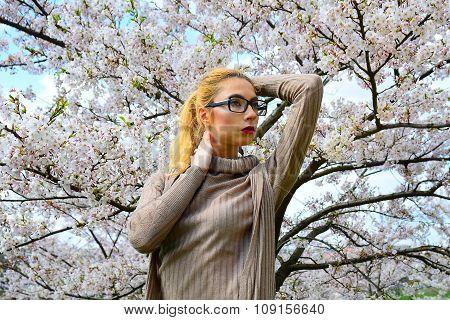 Young Girl Posing In The Sakura Garden