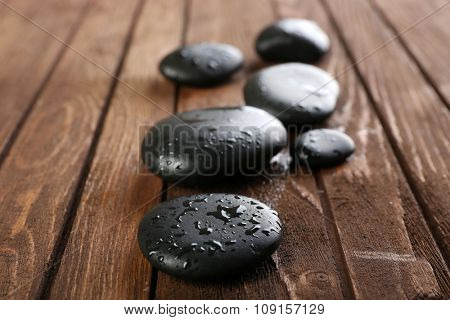 Spa stones on wooden background