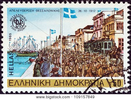 GREECE - CIRCA 1985: A stamp printed in Greece shows Greek army liberating Thessaloniki, 1912
