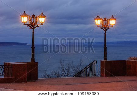 Two street light lantarns on the background of a sky