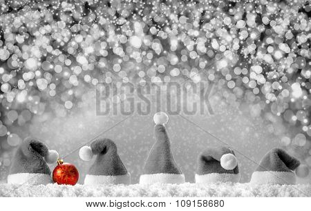 Red Santa hats isolated on silver  bokeh background.