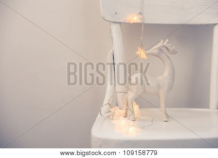 Christmas lights and ceramic deer