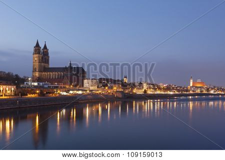 Skyline of Magdeburg on the Elbe river at dusk