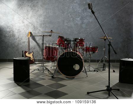 Drum set on brick wall background