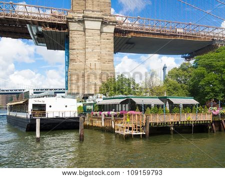 NEW YORK,USA - AUGUST 20,2015 : The famous River Cafe restaurant next to the Brooklyn Bridge in New York