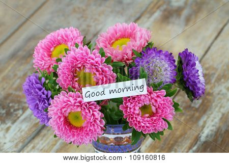 Good morning card with colorful aster flowers bouquet on rustic wooden surface
