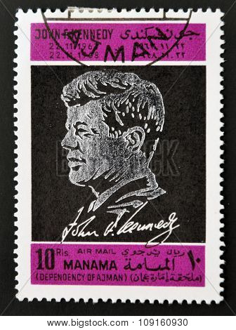 AJMAN - CIRCA 1970: A stamp printed in Ajman shows John F. Kennedy circa 1970