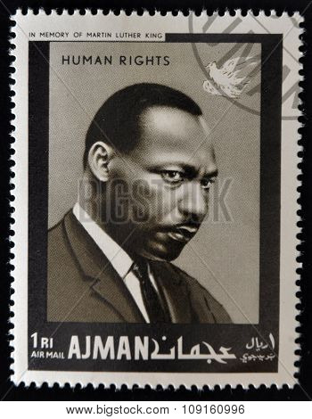 AJMAN - CIRCA 1974: Stamp printed in Ajman in memory of Martin Luther King Human Rights circa 1974