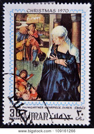 AJMAN - CIRCA 1970: Stamp printed in Ajman shows Paumgartner altarpiece by Durer circa 1970
