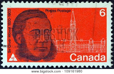 CANADA - CIRCA 1970: A stamp printed in Canada issued for the 150th anniversary of his birth shows statesman Sir Oliver Mowat and Parliament, circa 1970
