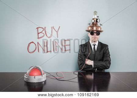 Buy online concept with vintage businessman and calculator