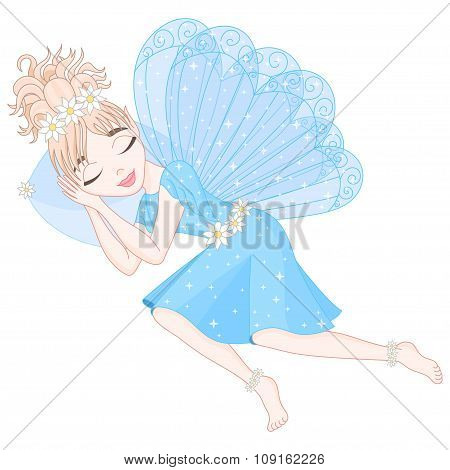 Cute fairy in blue dress with wings is sleeping on pillow